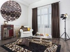 Коричневые шторы в гостиной – изысканный вариант для любого стиля интерьера