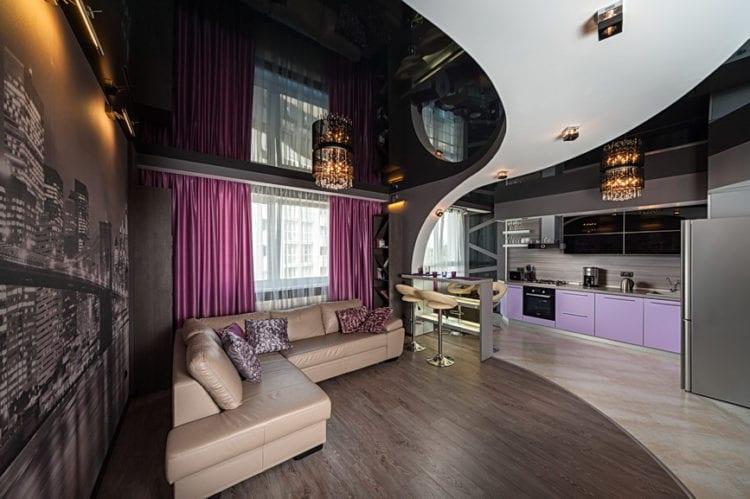 Натяжной потолок в гостиной зонирование