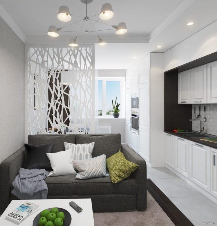 Кухня в студии, совмещенная с гостиной, с зонированием с помощью легкой перегородки