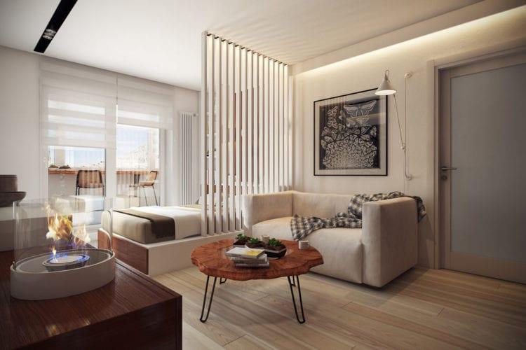 На фото – гостиная со спальней, разделенные цветом напольного покрытия.