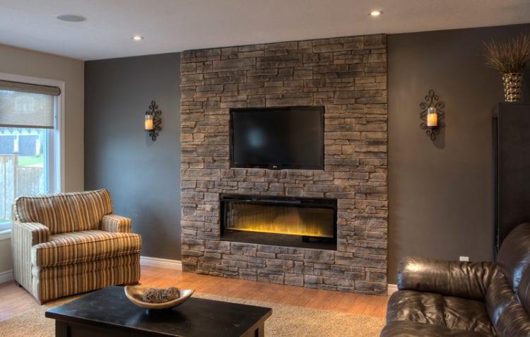 Камень в интерьере гостиной в покрытии стен