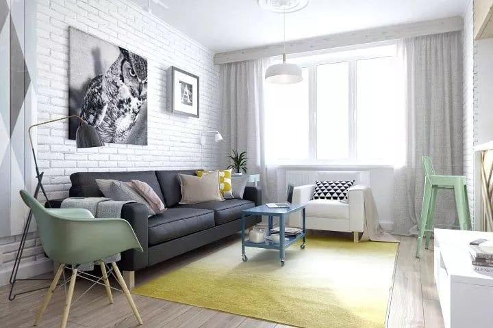 Интерьер гостиной с белой кирпичной стеной