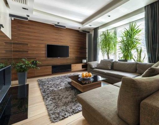 Ламинат на стене в гостиной – оригинальное решение для стильного интерьера